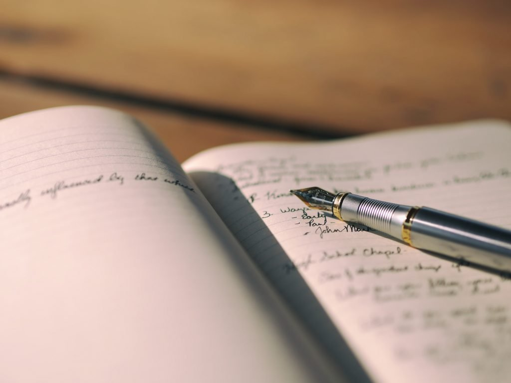Picture of a pen on a journal from a golfer practicing gratitude