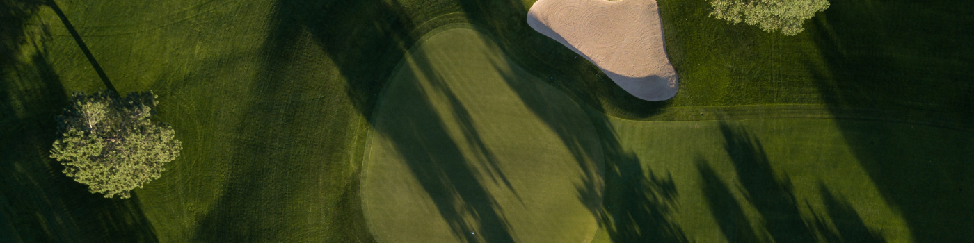 Aerial view of green surrounded by a bunker