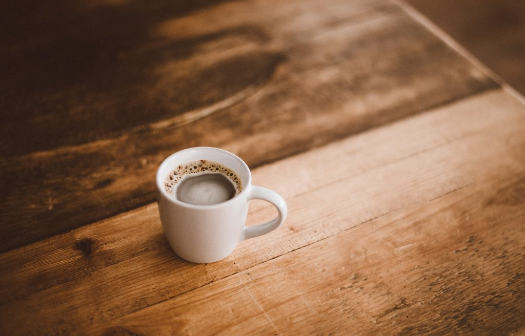 Full Cup Of Coffee On Table